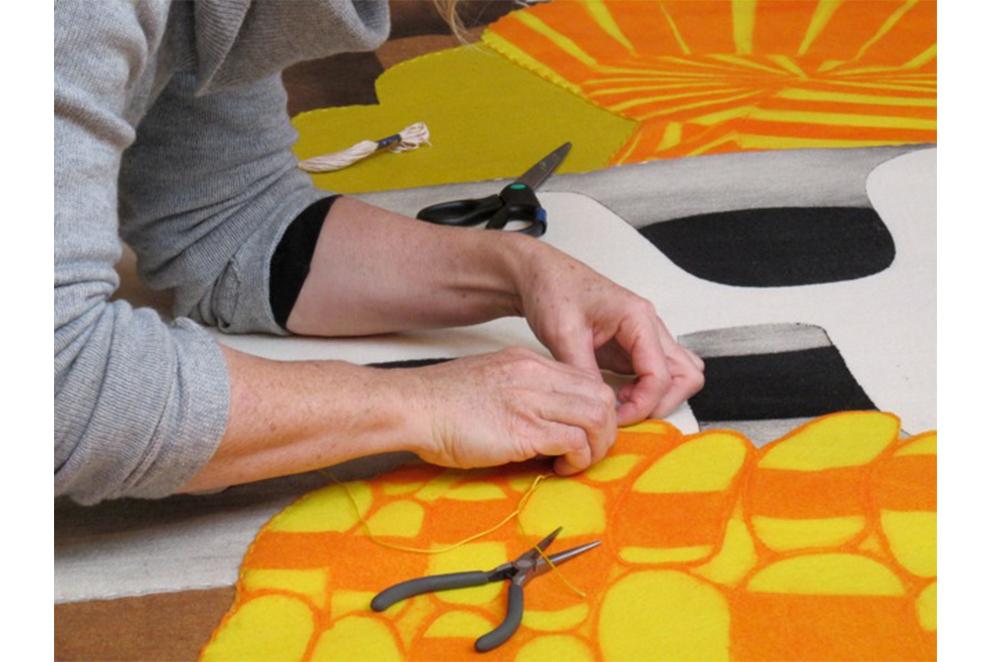 Sarah Amos stitching in studio